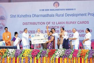 Prime Minister Narendra Modi distributes RuPay cards at the launch of the 'Digitised SHG Member Transaction' programme. Photo: PTI