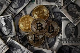 At $9,600 apiece, the total value of all bitcoins—their market cap—now tops $155 billion. Photo: Reuters