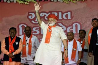 PM Narendra Modi, during an election rally on Wednesday, declared that his home state of Gujarat will not tolerate the Congress's 'baseless allegations against a son of the soil'. Photo: PTI