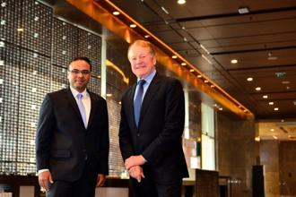 Umesh Sachdev, co-founder and CEO of Uniphore Software Systems, and Cisco executive chairman John Chambers. Photo: Priyanka Parashar/Mint