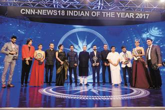 Finance minister Arun Jaitley (centre) with the winners of the CNN-News18 Indian of the Year 2017 awards. Photo: Pradeep Gaur/Mint