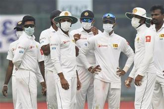 Sri Lankan players wear anti-pollution masks on the field, as the air quality deteriorated during the second day of their third test cricket match against India in New Delhi on Sunday. Photo: PTI