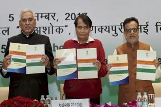 Commerce minister Suresh Prabhu, minister of state C.R. Chaudhary and finance secretary Hasmukh Adhia at the mid-term review of the foreign trade policy in New Delhi on Tuesday. Photo: PTI