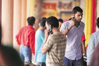 Fifty-six per cent of mobile phone users in India still use feature phones. Photo: Pradeep Gaur/Mint