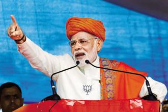 Prime Minister Narendra Modi addresses an election rally at Dhandhuka village of Ahmedabad district on Wednesday. Photo: PTI