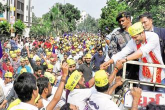 PAAS convener Hardik Patel with his supporters during an election rally in Surat. Photo: PTI