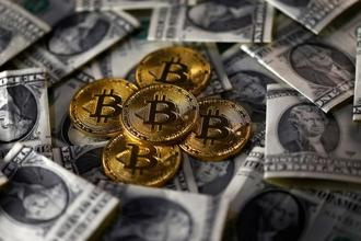 The first bitcoin future trades kick off Sunday at 6 pm EST on Cboe Futures Exchange, followed a week later by CME, and Nasdaq plans to get into the mix next year. Photo: Reuters