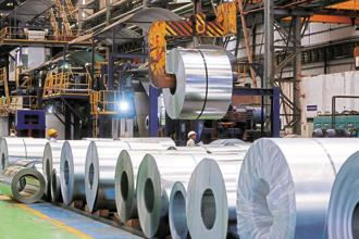 ArcelorMittal and SAIL are said to be in talks with the state governments of Andhra Pradesh and Gujarat to acquire land for their autograde steel plant. Photo: Bloomberg