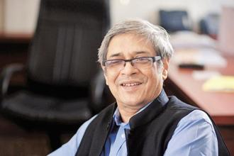 Bibek Debroy conceded that goods and services tax (GST) is not perfect because of multiple rates and exemptions, but stressed that the this is a step in the right direction. Photo: Pradeep Gaur/Mint