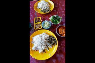 Rice with brinjal, greens, white pea chutney and fish curry at a roadside shack. Photos: Samar Halarnkar