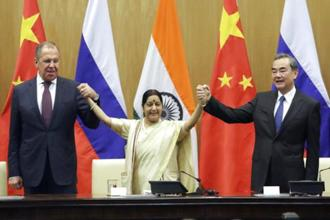 Foreign minister Sushma Swaraj holds hands with her Chinese and Russian counterparts Wang Yi, right and Sergey Lavrov after a press statement at the end of their meeting in New Delhi on Monday. Photo: AP