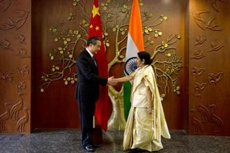 Indian foreign minister Sushma Swaraj shakes hand with her Chinese counterpart Wang Yi before their delegation level meeting in New Delhi on Monday. Photo: AP