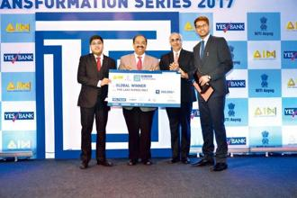 The IIM Shillong team, winners of the YES Bank Transformation Series 2017, receives the award from Ramanan Ramanathan (second from left), mission director at Atal Innovation Mission, NITI Aayog, and Ashok Chawla, chairman of the Energy and Resources Institute. Photo Ramesh Pathania/Mint