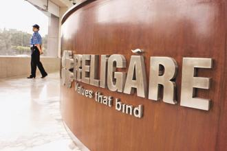 Religare Enterprises is holding company for its diversified financial services groups. On Tuesday, shares of the company closed 3.07% down at Rs60 on BSE. Photo: Bloomberg