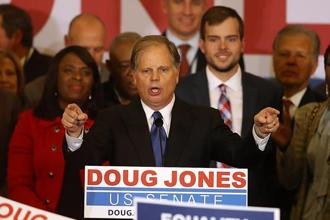 Democratic US Senator-elect Doug Jones speaks to supporters during his election night gathering at the Sheraton Hotel on Tuesday in Birmingham, Alabama. Photo: AFP