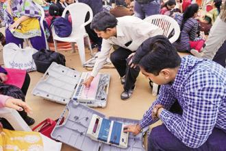 Poll officials check EVMs in Ahmedabad a day before the second phase of the Gujarat assembly elections. Photo: PTI