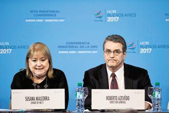 WTO director general Roberto Azevedo with Susana Malcorra (left), chairperson of the 11th WTO ministerial conference. Photo: AFP