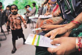 While officials say Aadhaar is saving the government billions of dollars by better targeting beneficiaries of subsidized food and cash transfers, critics point to unfair exclusions and data leaks. Photo: Priyanka Parashar/Mint