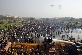 Protesters shout slogans as police use water canon to disperse them in New Delhi on 22 December 2012, in the aftermath of the gang rape. Photo: AP