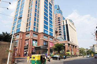A file photo of a commercial building in Bengaluru. Prime commercial hubs in Bengaluru, Pune and Chennai have either reached or surpassed the 2008-peak level in the last one year, as per JLL data. Photo: Hemant Mishra/Mint