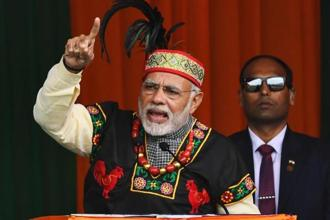 Prime Minister Narendra Modi gestures while addressing a Bharatiya Janata Party rally, dressed in traditional Khasi tribe attire and Garo tribe headgear, in Shillong on Saturday. Photo: AFP