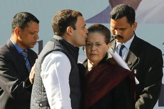 Rahul Gandhi, newly elected president of India's main opposition Congress party, kisses the forehead of his mother and leader of the party Sonia Gandhi after taking charge as the president during a ceremony at the party's headquarters in New Delhi on Saturday. Photo: Reuters
