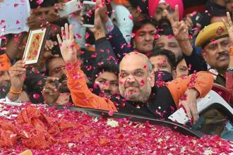BJP president Amit Shah gestures while being welcomed on his arrival at the party headquarters in New Delhi on Monday, after the party's victory in the assembly elections in Gujarat and Himachal Pradesh. Photo: PTI