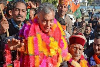 BJP candidate Anil Sharma celebrates with his father and former union minister Sukh Ram after winning the Himachal elections, in Mandi on Monday. Photo: PTI