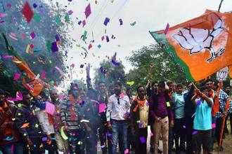 BJP supporters after the party's victory in Gujarat elections in Gandhinagar on Monday. Photo: PTI