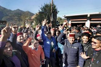 BJP supporters celebrating their party's success in Himachal Pradesh assembly elections outside a counting centre, at Chamba on Monday. Photo: PTI
