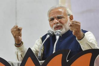 PM Narendra Modi addresses a felicitation function before BJP's parliamentary board meeting in New Delhi on Monday, after the party's win in Himachal Pradesh and Gujarat elections. Photo: PTI