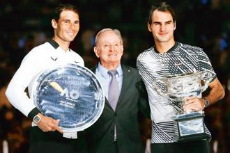 Roger Federer (right) and Rafael Nadal (left) pose with their trophies alongside former Australian tennis player Rod Laver after their men's singles final match at the Australian Open 2017. Photo: Reuters