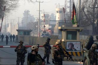 Afghan security forces keep watch at a check point close to the compound of Afghanistan's national intelligence agency in Kabul. Photo: Reuters