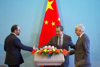 (From left) Afghanistan foreign minister Salahuddin Rabbani, Chinese foreign minister Wang Yi and Pakistani foreign minister Khawaja Asif after a press conference for their first tri-nation foreign ministers' dialogue held in Beijing on Tuesday. Photo: AP