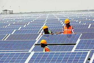 With most solar equipment currently imported, solar power firms are worried the imposition of anti-dumping duty will trip capacity addition plans, raising costs and questions about project viability. Photo: Mint