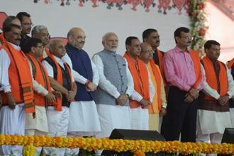 PM Narendra Modi, BJP national president, Amit Shah (centre L) and Gujarat CM Vijay Rupani (centre R) along with other BJP leaders and other CMs attending Rupani's swearing in ceremony in Gandhinagar on 26 December. Photo: AFP
