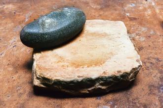 The sil batta—a rustic apparatus comprising a heavy, flat slab of grinding stone and a smaller stone muller.
