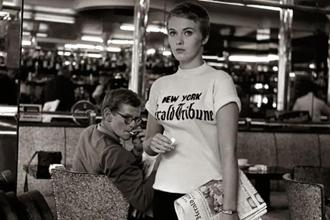 Jean Seberg in her New York Herald Tribune shirt in 'Breathless'—one of several cameos made by newspapers in Jean-Luc Godard's classic 1960 film.