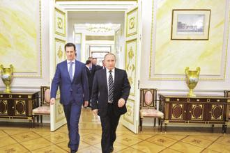 Vladimir Putin told his Syrian counterpart Bashar al-Assad in a new year's greeting that Russia will continue supporting Syria's efforts to defend its sovereignty. Photo: Reuters