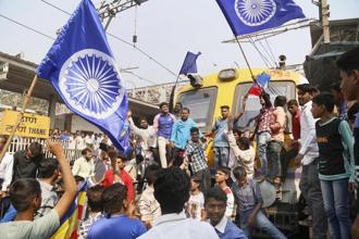 Dalit groups protest at Thane railway station during Maharashtra bandh on Wednesday after clashes in Bhima Koregaon near Pune. Photo: PTI