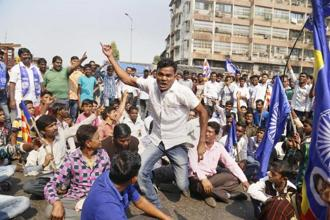 Dalit protesters block a road during Maharashtra bandh called over the Bhima-Koregaon violence in Thane, Mumbai, on Wednesday. Photo: PTI
