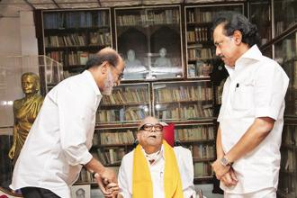 Rajinikanth (left) with DMK founder M. Karunanidhi (centre) and party working president M.K. Stalin in Chennai on Wednesday. Photo: PTI