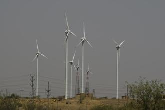India has registered record low wind and solar power tariffs of Rs2.43 per kilowatt-hour (kWh) and Rs2.44 per unit, respectively. Photo: Mint