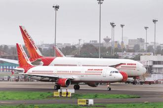 Air India, founded in the 1930s by the Tata Group before it was nationalised in 1953, is saddled with a debt burden of $8.5 billion and a bloated cost structure. Photo:  Abhijit Bhatlekar/Mint