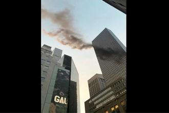 Smoke is seen rising from the roof of Trump Tower, in New York. Photo: Reuters