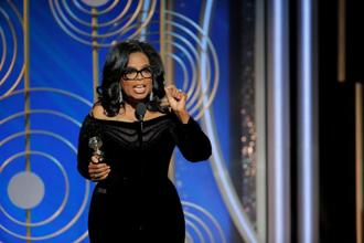 """For too long women have not been heard or believed if they dared to speak their truth to the power of those men,"" said Oprah Winfrey, accepting the Cecil B. DeMille Award for lifetime achievement at the Golden Globes. ""But their time is up. Their time is up!"" Photo: Reuters"