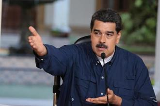 Nicolas Maduro's regime already is a military dictatorship, with officers in charge of many government agencies. Photo: Reuters