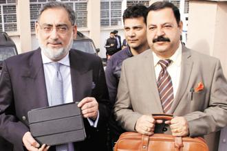 Jammu and Kashmir finance minister Haseeb Drabu (left) with minister of state (finance) Ajay Nanda at the state legislative assembly on Thursday. Photo: PTI