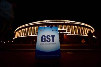 GST is an example of a transparent indirect tax regime which not only economically unifies the country but also creates economic efficiency. Photo: PTI