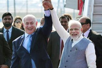 Prime Minister Narendra Modi receives his Israeli counterpart Benjamin Netanyahu on his arrival at Air Force station Palam in New Delhi on Sunday. Photo: PTI